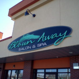 Low-profile building sign for a salon