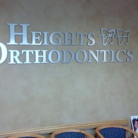 Heights Orthodontics - lobby sign