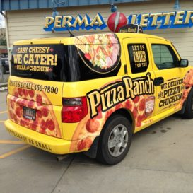 Delivery vehicle graphics for a pizza company.