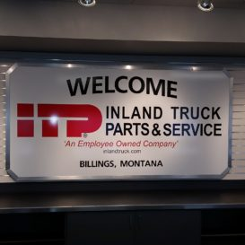 Inland Truck Parts & Service - Simple interior sign